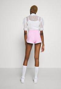 Nike Sportswear - Tracksuit bottoms - pink - 2