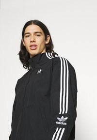 adidas Originals - LOCK UNISEX - Tunn jacka - black - 3