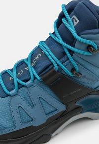 Salomon - X ULTRA 4 MID GTX - Hiking shoes - copen blue/black/dark denim - 5