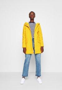 ONLY Tall - ONLSALLY RAINCOAT - Parka - golden yellow - 1