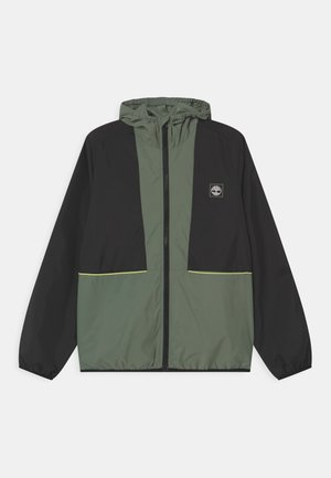HOODED WINDBREAKER - Light jacket - green