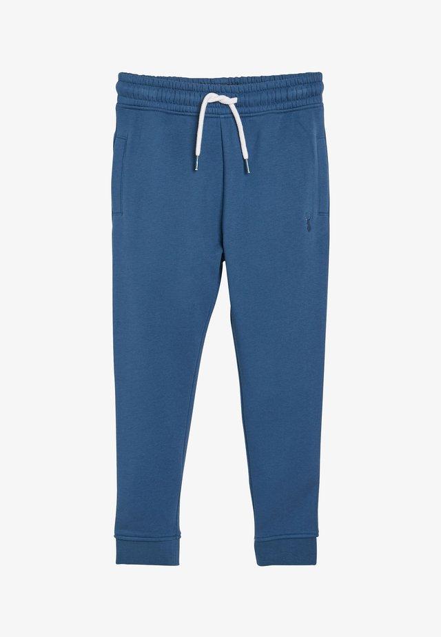 CUFFED - Teplákové kalhoty - blue