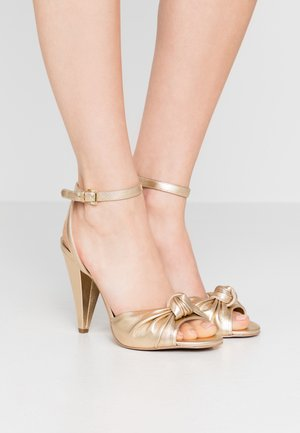 SURI  - High heeled sandals - pale gold