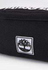 Timberland - BUM BAG - Taška spříčným popruhem - black - 5