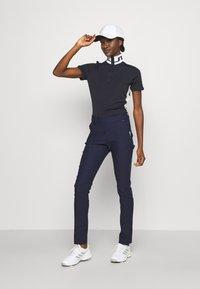 J.LINDEBERG - PIPER GOLF - T-shirt sportiva - navy - 1