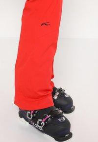 Kjus - WOMEN FORMULA PANTS - Snow pants - fiery red - 5