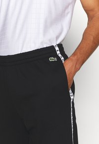 Lacoste Sport - PANT TAPERED - Tracksuit bottoms - black - 4