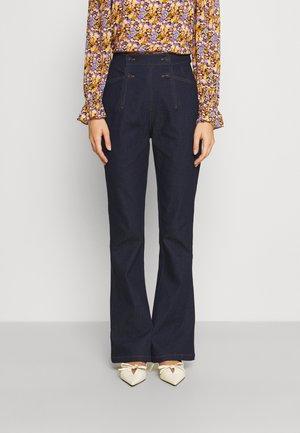 EDAN PANTS - Bootcut jeans - denim blue