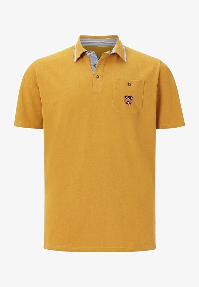 EARL DENNIS - Polo shirt - gelb