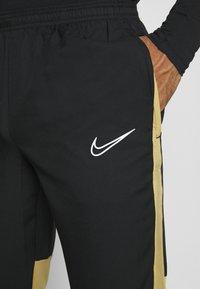Nike Performance - DRY ACADEMY PANT - Verryttelyhousut - black/jersey gold/white - 3