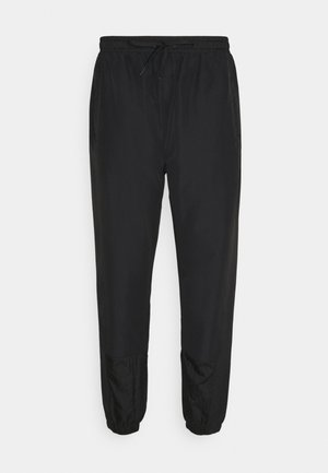 STOREO - Pantalon de survêtement - black