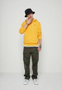 Levi's® - NEW ORIGINAL HOODIE  - Hoodie - yellows/oranges - 1