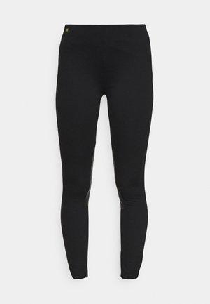ATHEDORA  - Leggings - black