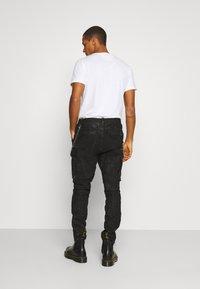 Tigha - ENRIQUE - Leather trousers - black - 2
