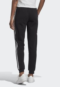 adidas Originals - SLIM CUFFED JOGGERS - Tracksuit bottoms - black - 1