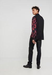 Just Cavalli - PANTS 5 POCKETS - Slim fit jeans - black - 2
