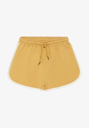 DORIA  - Tracksuit bottoms - golden apricot