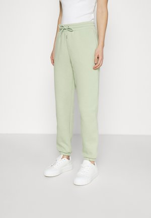 KARDI CUFF TROUSERS - Tracksuit bottoms - green dusty light