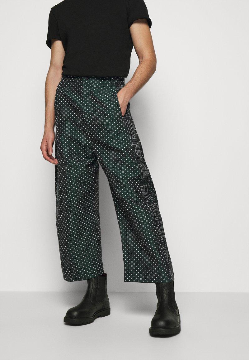 Henrik Vibskov - KEY PANTSMIX DRAIN MIXER - Trousers - dark green