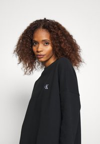 Calvin Klein Jeans - DRESS WITH CHEST LOGO - Day dress - black - 3