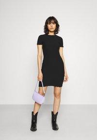 Tommy Jeans - BODYCON SMOCK DRESS - Shift dress - black - 1