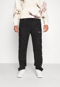 Pegador - SUEDE BUTTON PANTS UNISEX - Trousers - black - 0