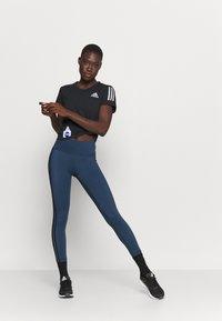 adidas Performance - SPACE TEE - Camiseta estampada - black - 1