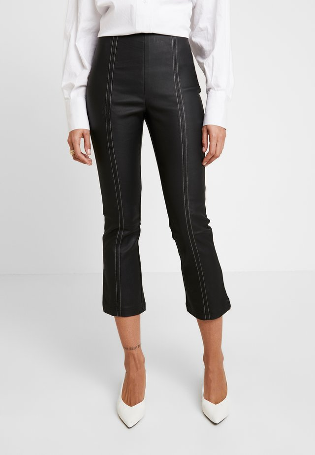 COATED CONTRAST STITCHING KICK FLARE TROUSER - Trousers - black