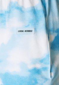 Local Heroes - SKY SWEATPANTS - Trainingsbroek - blue/white - 2