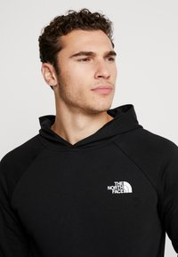 The North Face - RAGLAN HOODIE - Luvtröja - black/white - 3