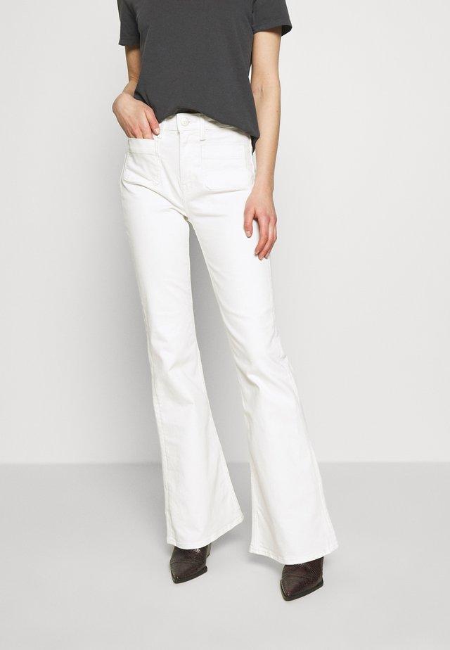 Jeans a zampa - rinse