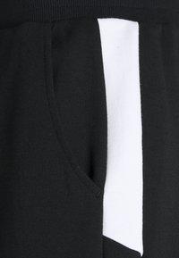Ellesse - IRISION SHORTS - Sports shorts - black - 2