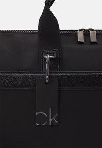 Calvin Klein - UNISEX - Weekend bag - black - 3