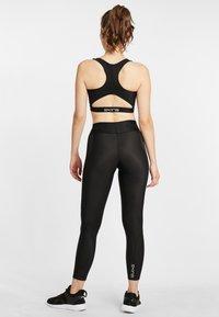 Skins - SKINS SPORT-BH S3  - Sports bra - black - 2