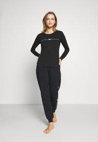 Emporio Armani - PANTS WITH CUFFS - Pyjama bottoms - nero - 1