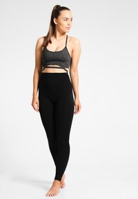 Filippa K - HIGH SEAMLESS LEGGING - Punčochy - black - 1
