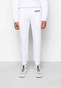 MOSCHINO - TROUSERS - Tracksuit bottoms - white - 0