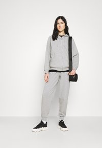 Topshop - JOGGER WITH GRAPHIC - Tracksuit bottoms - grey - 1