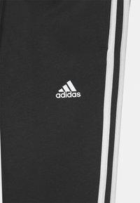adidas Performance - UNISEX - Verryttelyhousut - black/white - 2