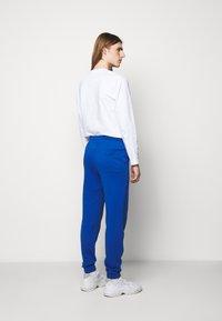 Holzweiler - HANGER TROUSERS - Pantaloni sportivi - blue - 2