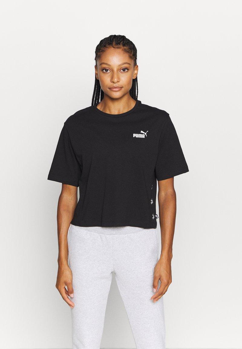 Puma - AMPLIFIED TEE - Print T-shirt - black