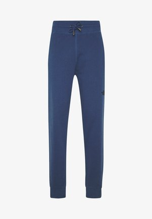 LIGHT PANT  URBAN - Tracksuit bottoms - blue wing teal
