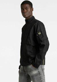 G-Star - SPORTY SLANTED POCKET INDOOR - Summer jacket - dk black - 2