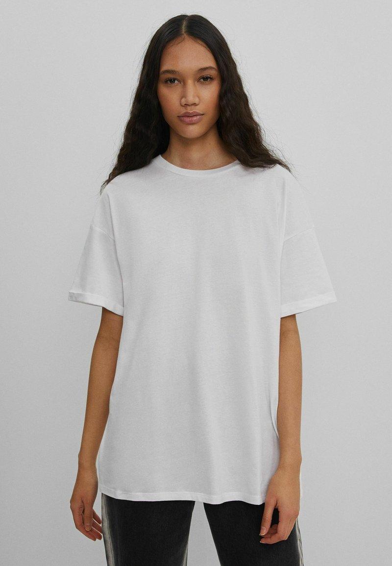 Bershka - Print T-shirt - nude