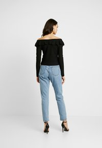 Nly by Nelly - POWERFUL FRILL - T-shirt à manches longues - black - 2