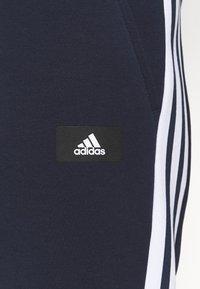 adidas Performance - 3 STRIPES FUTURE - Tracksuit bottoms - legend ink - 4