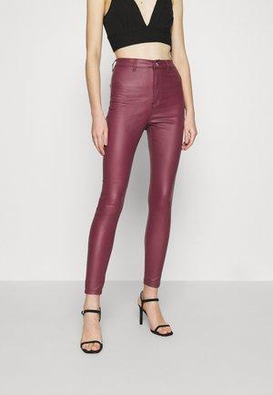 VICE HIGH WAISTED COATED - Stoffhose - burgundy