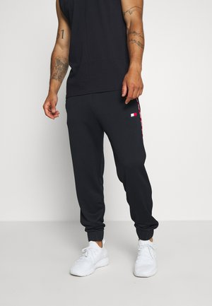 PIPING TRACKSUIT CUFFED PANT - Tracksuit bottoms - blue