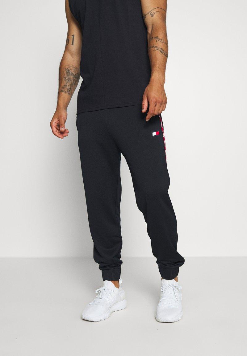 Tommy Hilfiger - PIPING TRACKSUIT CUFFED PANT - Pantaloni sportivi - blue
