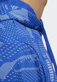 adidas Performance - ESSENTIALS ALLOVER PRINT HOODIE - Hoodie - blue - 7